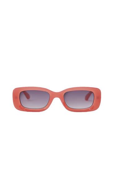 Lyserøde solbriller med resinstel