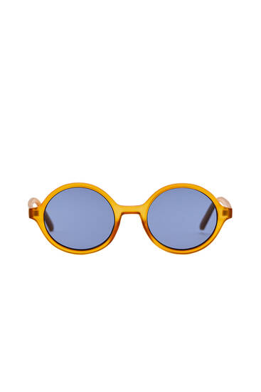 Round sunglasses with coloured lenses