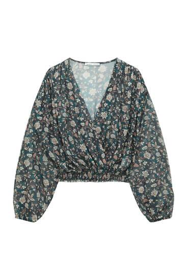 Блуза из полупрозрачной ткани с цветочным принтом
