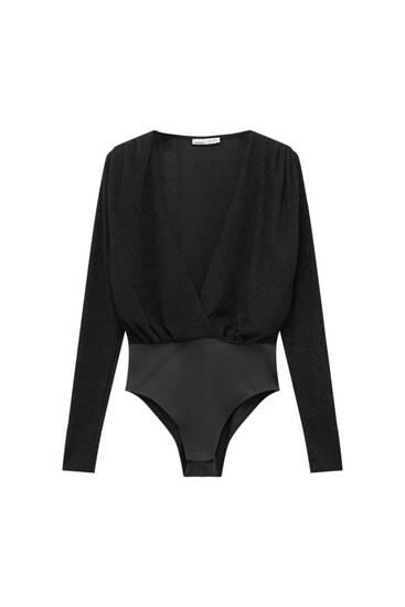 Black V-neck bodysuit with shoulder pads