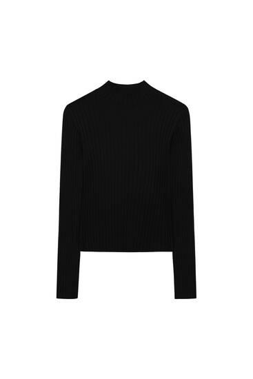 Ribcord trui met hoge kraag en split