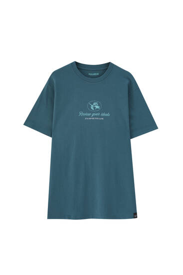 Green print T-shirt with a contrast slogan