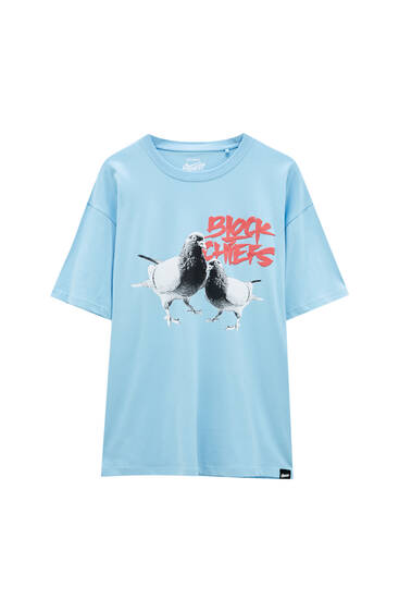 Blue T-shirt with pigeon illustration
