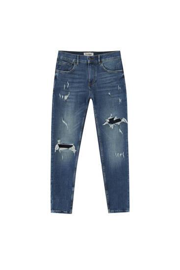 Jeans skinny fit premium com rasgões na perneira