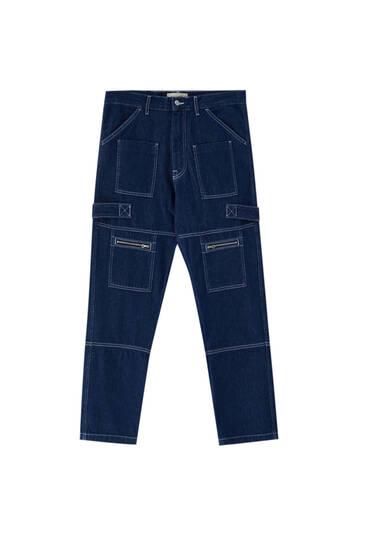 Сині джинси в утилітарному стилі