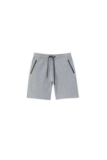 Basic Bermuda jogging shorts with zips