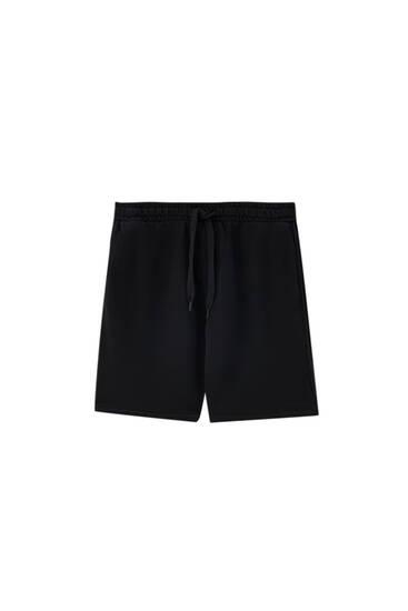 Coloured garment-dyed jogger Bermuda shorts