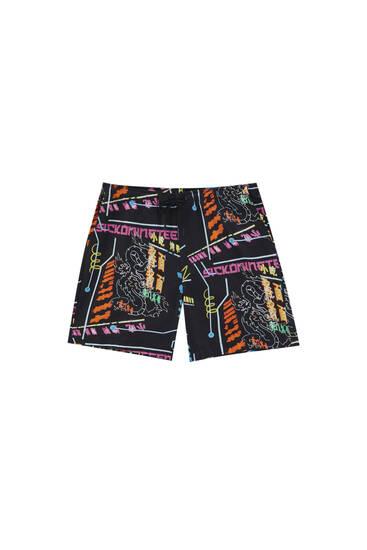 Black Bermuda shorts with slogan print