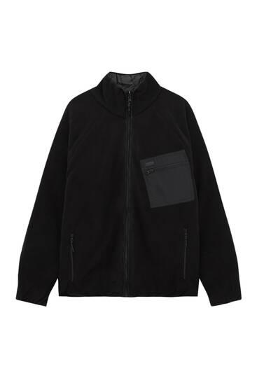 Schwarze Wendejacke aus Fleece