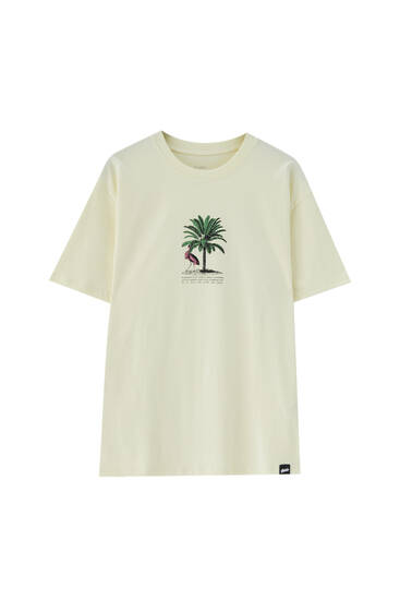 Yellow T-shirt with palm tree illustration