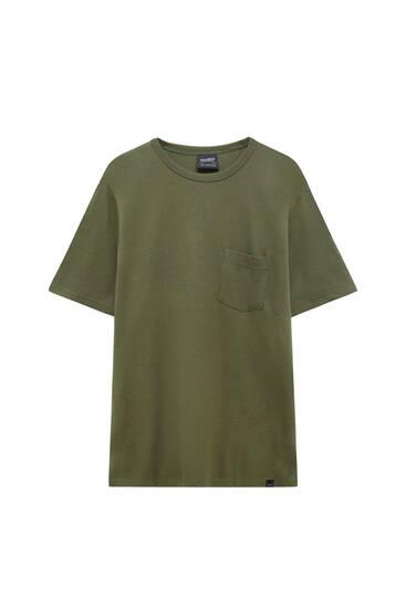 Camiseta waffle bolsillo delantero