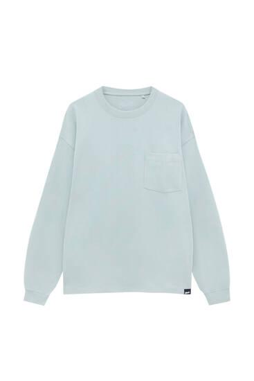 Camiseta básica manga larga bolsillo