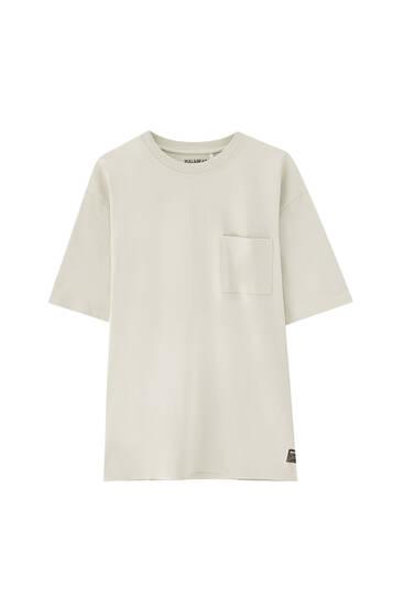 Camiseta oversize tejido premium bolsillo