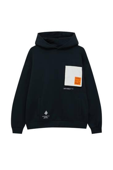 Black hoodie with orange label