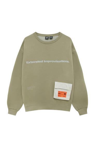 Khaki sweatshirt with orange label