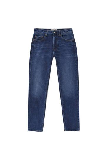 Темно-сині джинси вузького крою