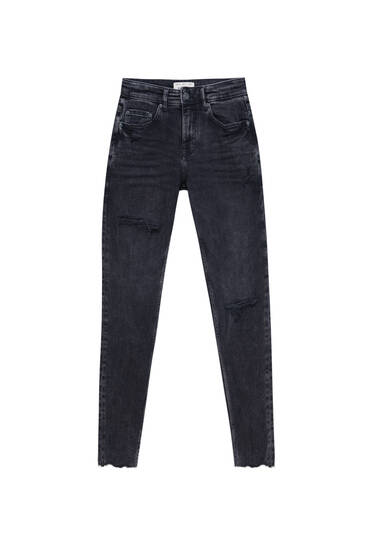 Jeans super skinny fit em tecido premium com rasgões