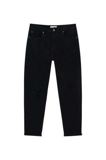 Schwarze Jeans im Carrot-Fit mit Zierrissen