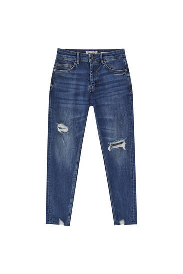 Premium fabric carrot fit jeans with ripped detailing