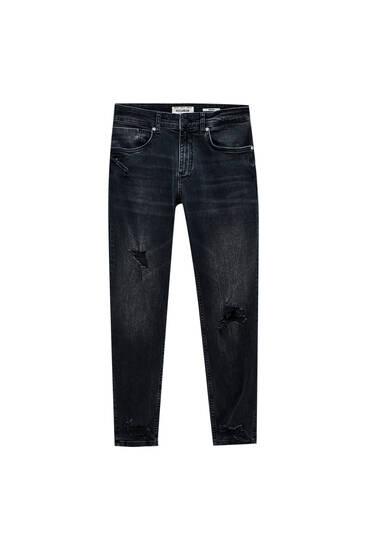 Jeans skinny fit premium com pormenor de rasgões na perneira