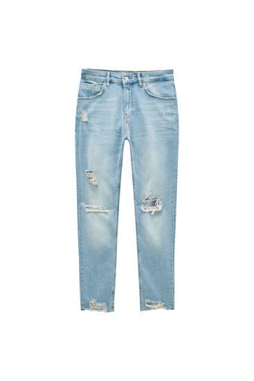 Jeans skinny fit de tecido premium com rasgões