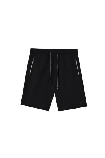 Bermuda jogging shorts with zips