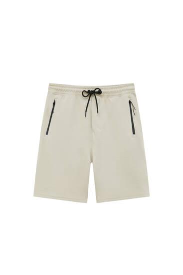 Bermudes jogger butxaques cremallera