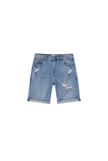 Slim fit denim Bermuda shorts with ripped detail