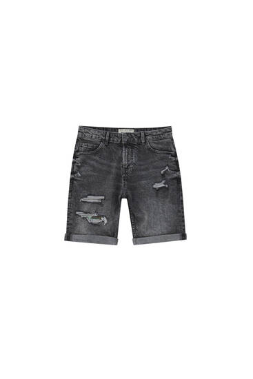 Ripped denim Bermuda shorts - Contains recycled cotton