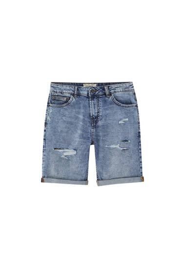 Blue slim fit denim Bermuda shorts with rips