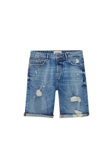 Ripped slim fit blue denim Bermuda shorts
