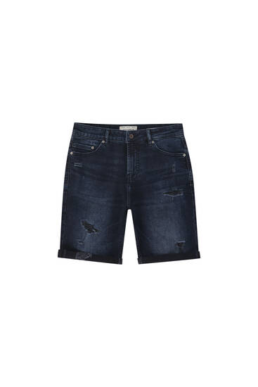 Blue slim-fit denim Bermuda shorts with ripped detail - Contains recycled cotton