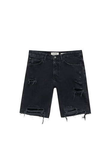 Slim fit denim Bermuda shorts with ripped legs