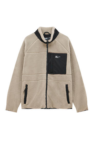Jacke aus Lammfellimitat mit kontrastfarbenen Details
