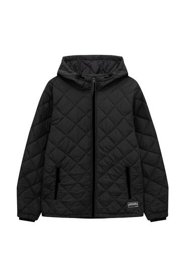 Quilted jacket with label detail