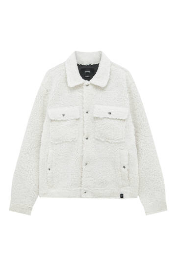 Trucker jacket with faux shearling details