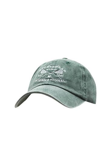 Faded green cap