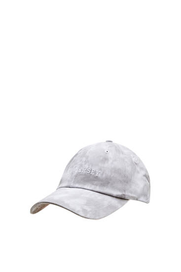 Tie-dye cap with embroidered slogan