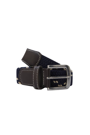Stretch fabric belt with metallic buckle