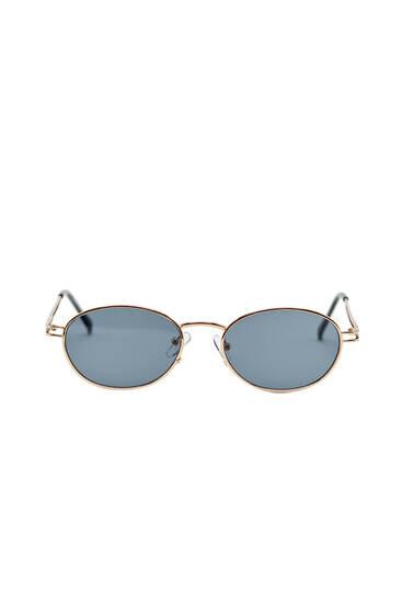 Gafas sol montura ovalada metalizada