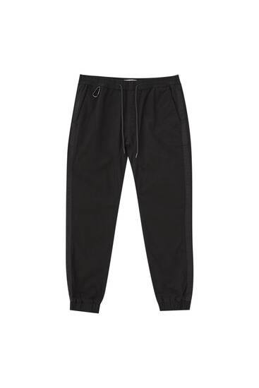 Black jogger jeans with lobster clasp detail