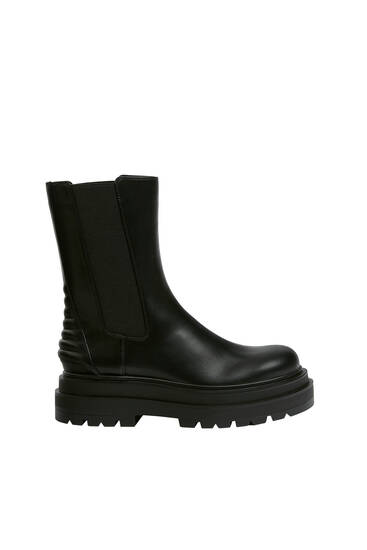 Flat ankle boots with padded detail.