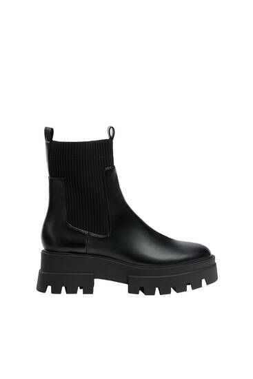 Track sole sock boots