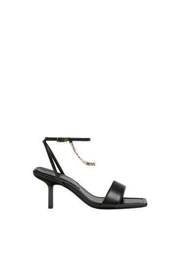 Heeled sandals with chain detail