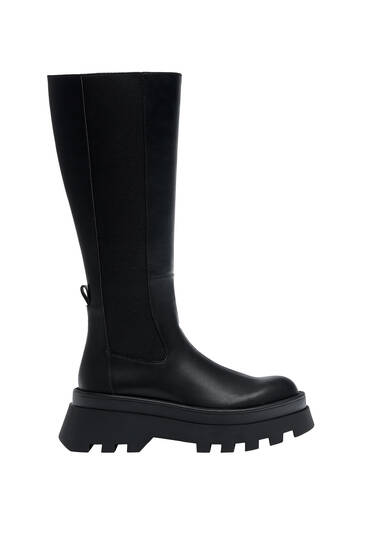 Track sole boots with elastic gores