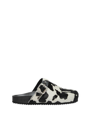 Cowhide print leather clogs