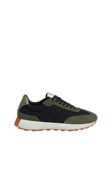 Trainers with leather pieces