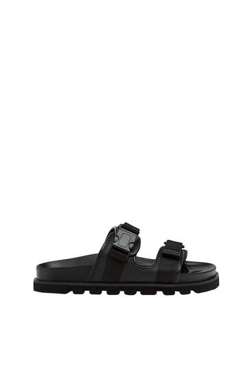 Strappy sandals with buckle details