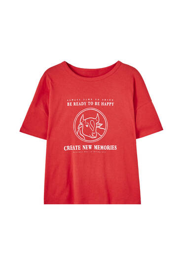 Red T-shirt with cow illustration