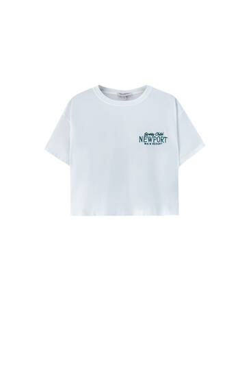 White T-shirt with green embroidery